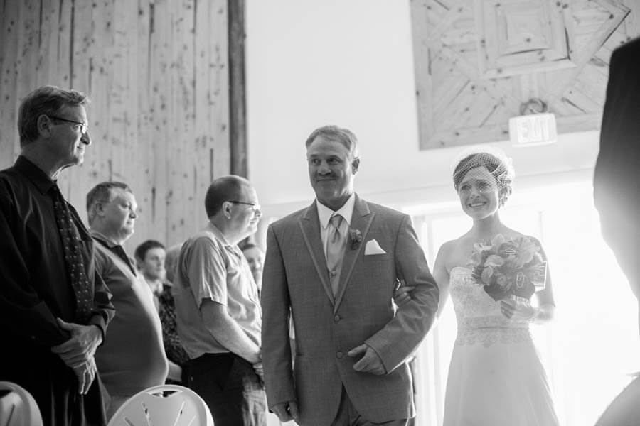 Walking down the aisle in Badger Farms' barn