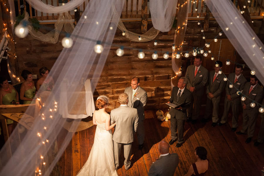 Giving away the bride inside the barn